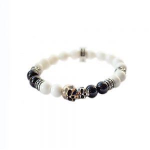 Браслет серебряный, бронза, чернение, шары сделаны из природного агата и коралла. Размер шаров 8 мм.